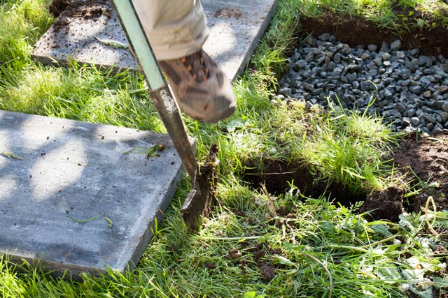 Landscaping installing Paving stones removing grass